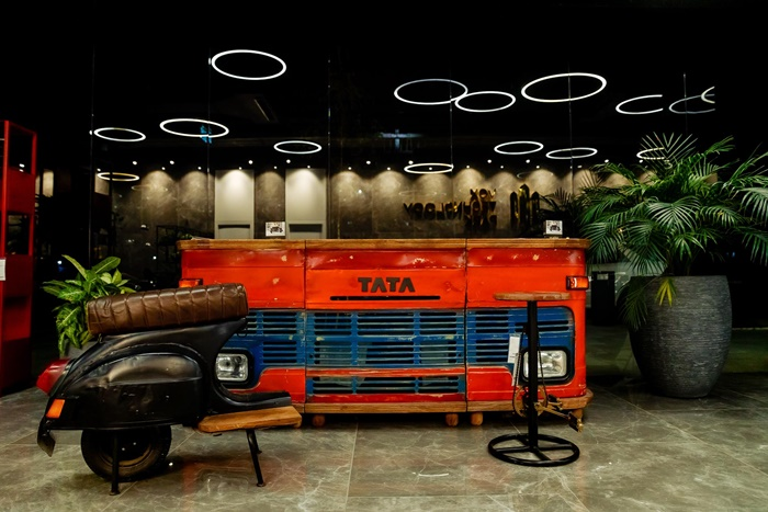 Old entry doors, tractors and fishing boats become furniture in a exclusive exhibition by mömax & Vox Technology Park